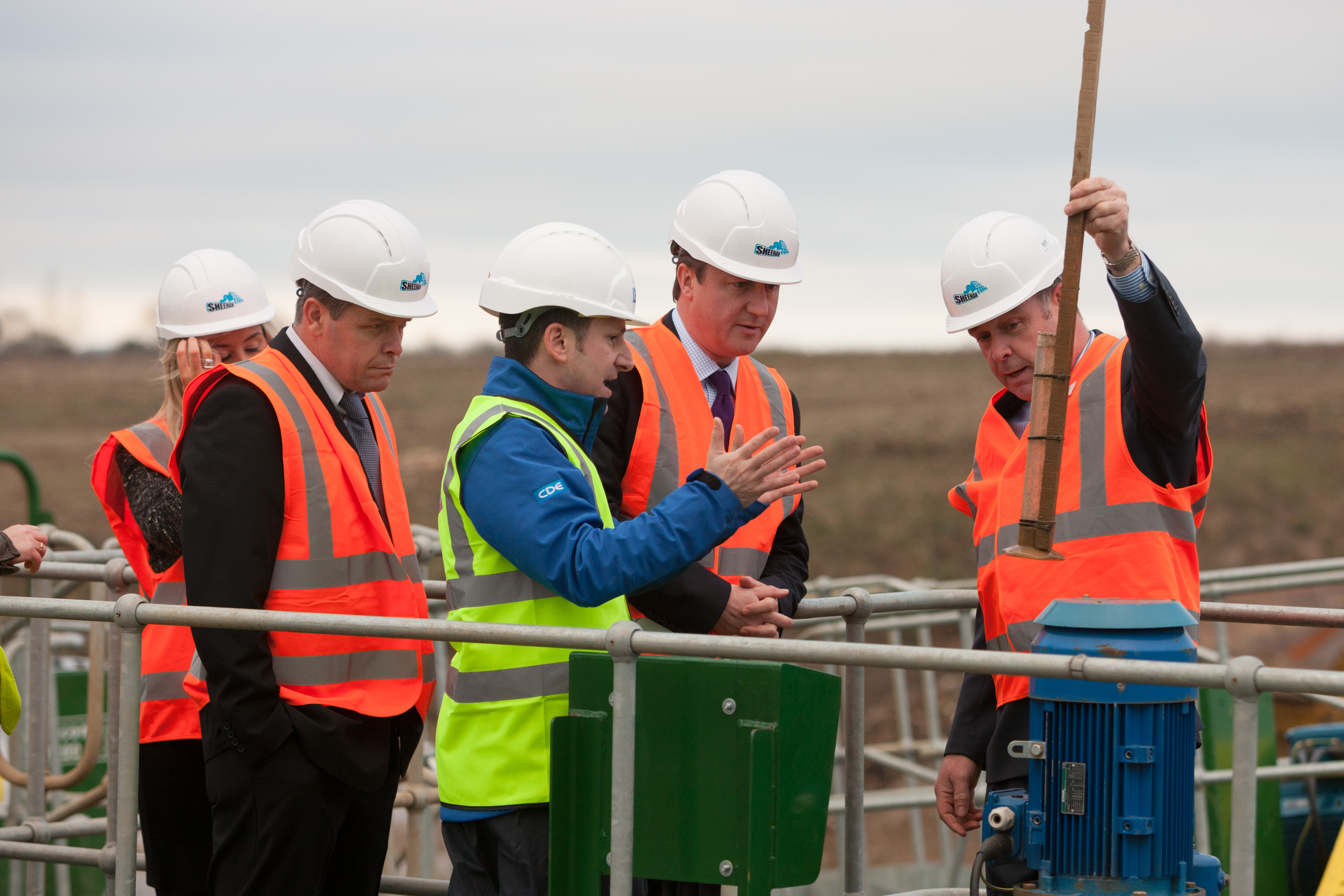 Chris and Brendan demonstrate the plant to David Cameron