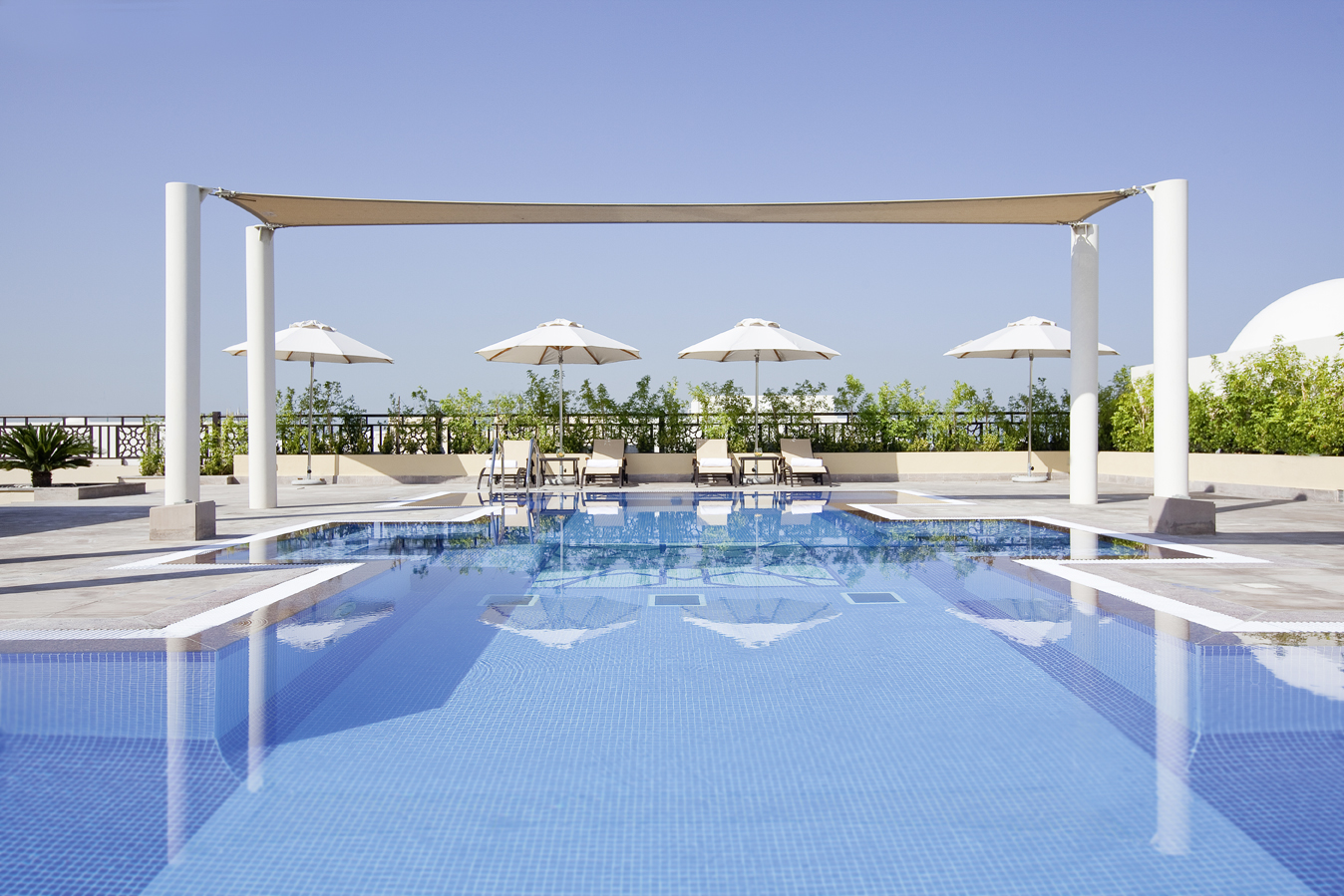 Unwind and relax at the Pool - Mövenpick Hotel Apartments The Square Dubai