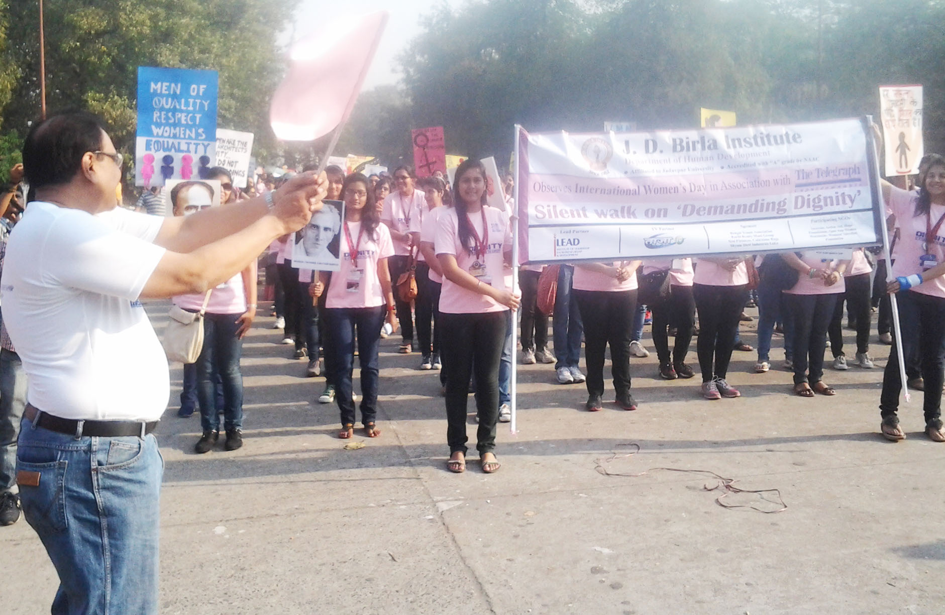 Mr. Pradip Chopra flagging off the Walk on International Women's Day on  Demanding Dignity