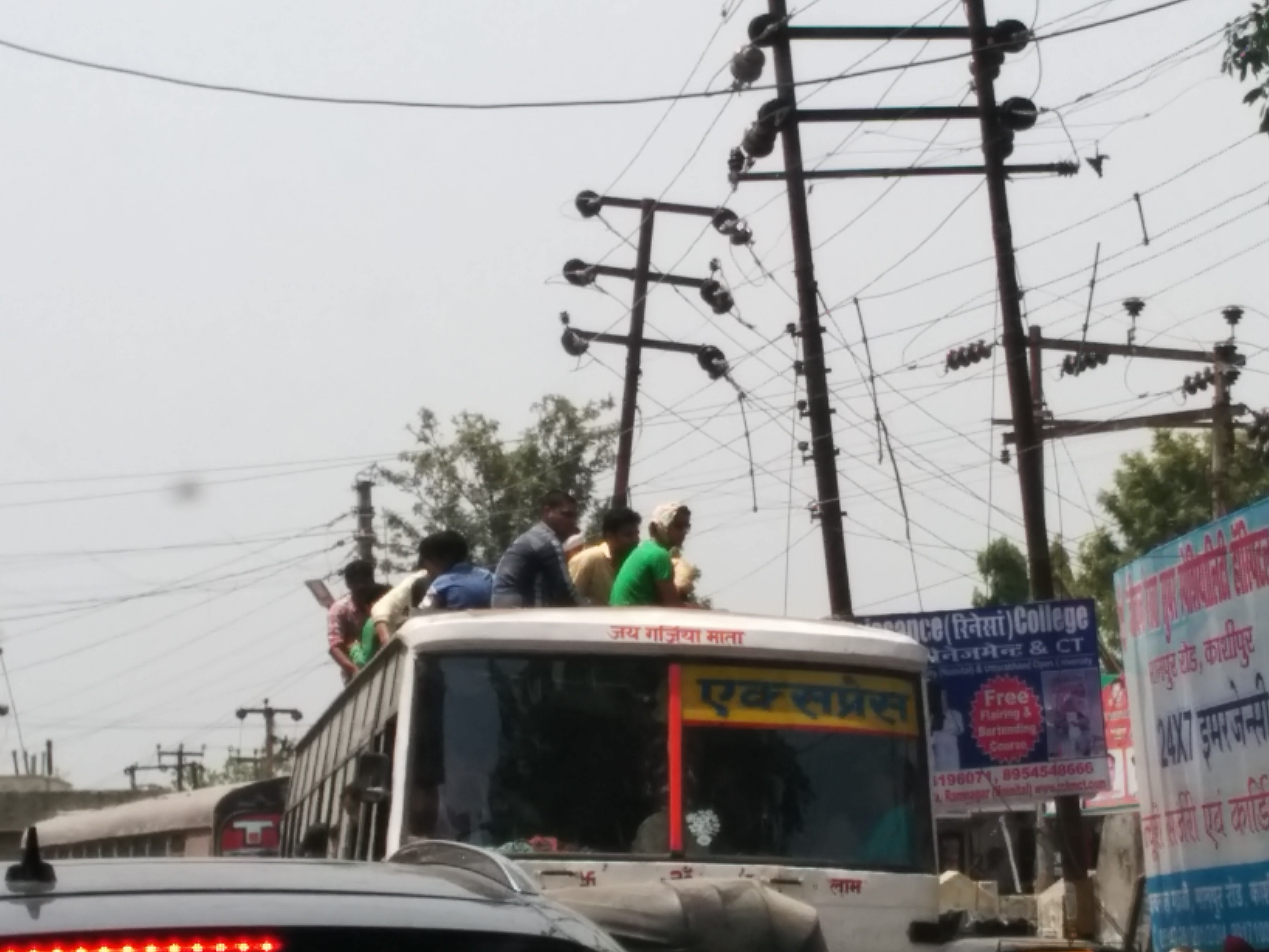 Sitting dangerously atop a bus_Autocar India Uncool Moments