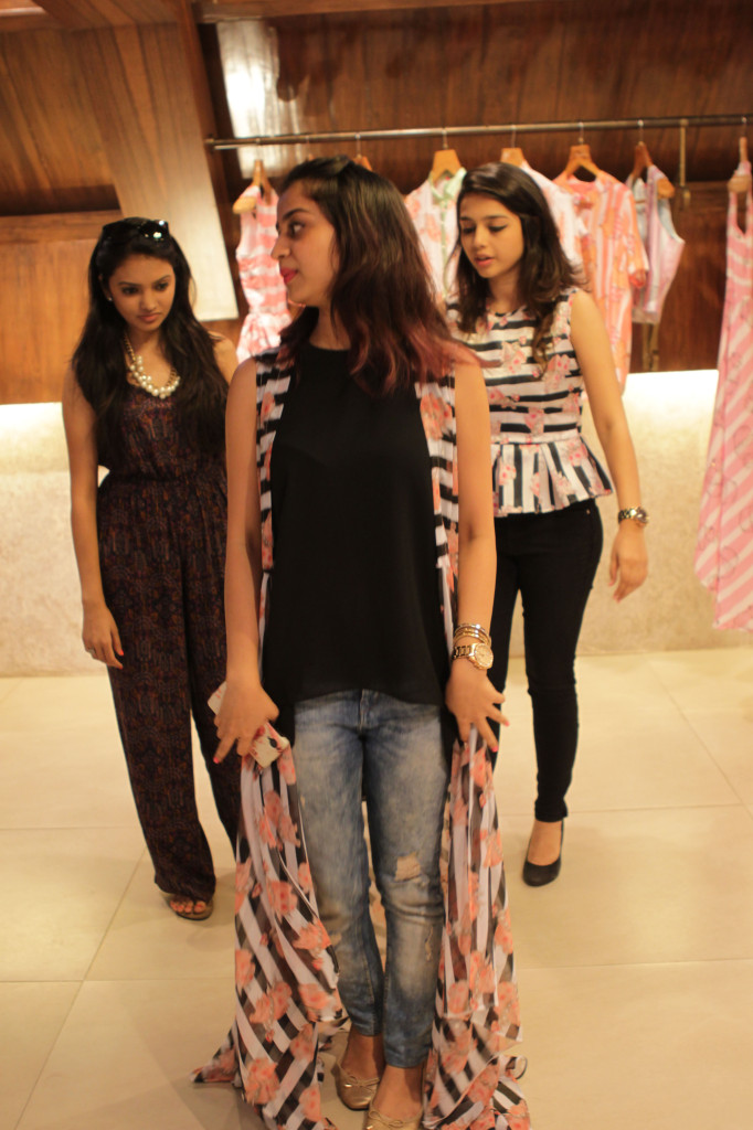 Clients trying on Sonam Parmar's collection copy