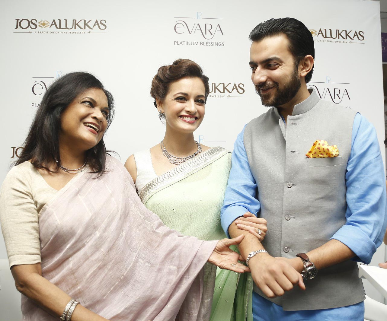 (L-R) Dia's mother Deepa Mirza; Dia Mirza & Dia's husband Sahil Sangha at the unveiling of Platinum 'EVARA' on Tuesday at Jos Alukkas Jewellery, Punjagutta.