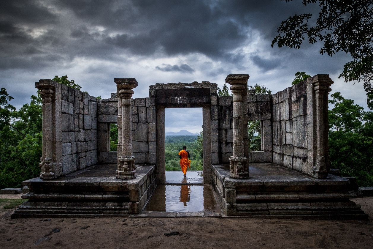 GENERIC.  PICTURE SHOWS:  A buddhist monk at the temple ruins of Yapahuwa, Sri Lanka. The great temples of Sri Lanka are remnants of an ancient empire that prospered on its ability to harness the monsoon rains, building great reservoirs to ensure a plentiful supply of water all year round.