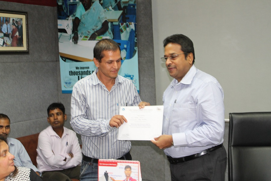 Dr. Darlie Koshy giving certificates to the participants