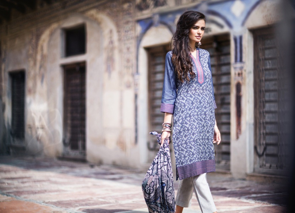 Stylish straight fit kurta with Ikat print front panel made in denim with lace trims by Rangriti