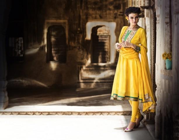 Festive kalidar kurta in Yellow art silk with gota patti on yoke and borders by Rangriti