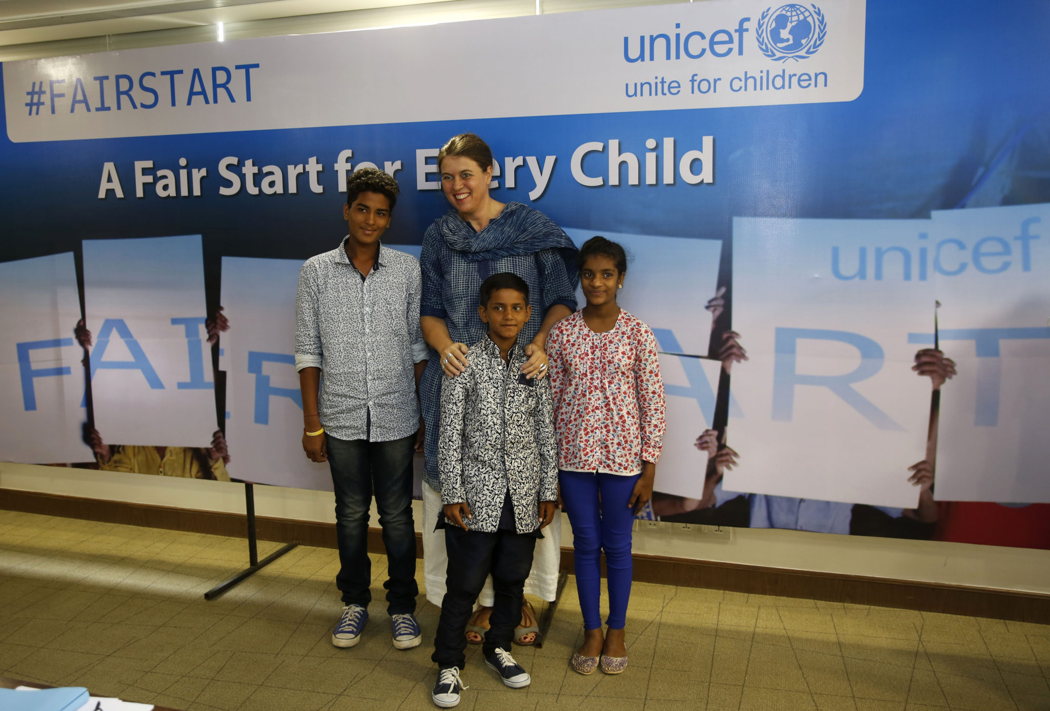 Chief Advocacy and Communication, Unicef India, Caraline Den Dulk, centre, poses with the crew of #FairStart campaign, Cameraman Sahil, left, Art Director Suraj, centre foreground, and Costume organiser Belinda after a press conference in New Delhi, India, Wednesday, May 25, 2016. Photographer/ Mustafa Quraishi