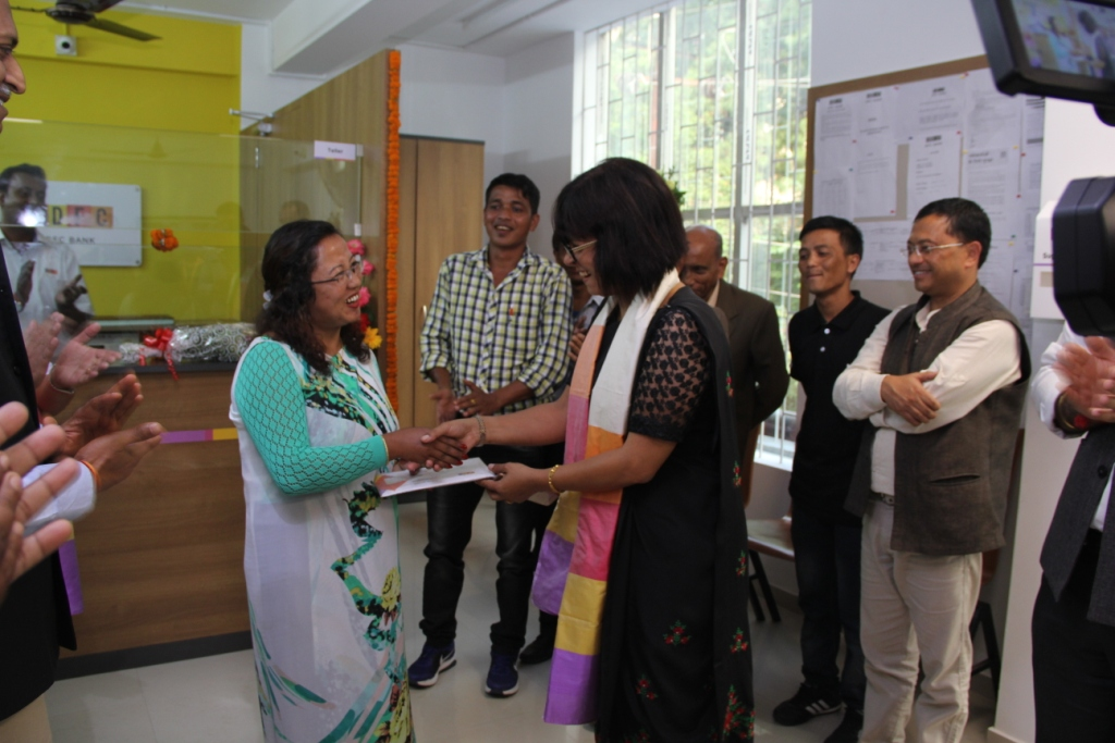 M. Ampareen Lyngdoh  Minister for Urban Affairs  Meghalaya handing over the welcome kit to the first customer