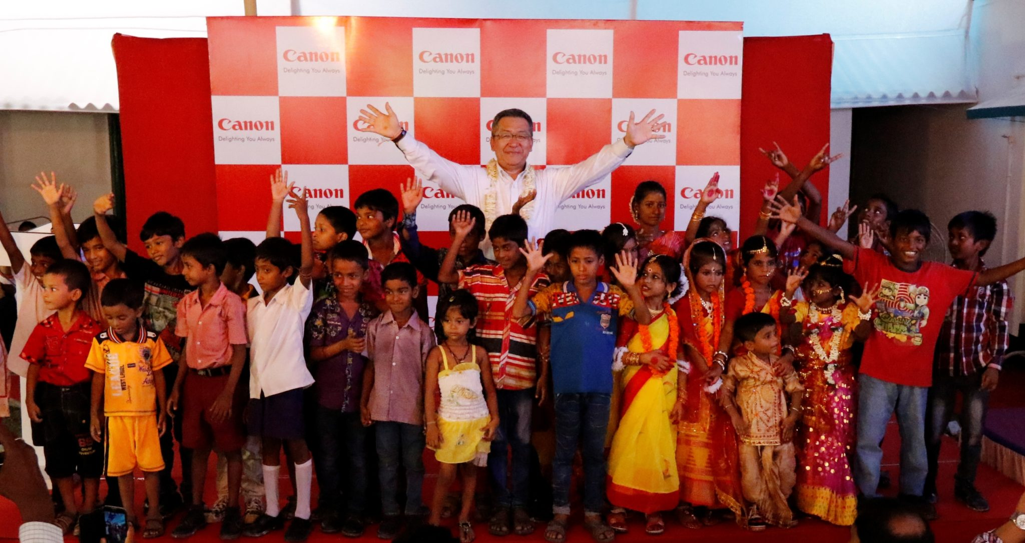 Mr. Kazutada Kobayashi  President & CEO  Canon India brings smiles to young faces at the first anniversary celebratio_